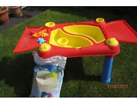 Childs sand pit hardly used. with bag of unopened play pit sand