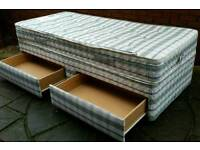 Slumberland single divan bed with 2 storage drawers, quality mattress. in excellent condition.