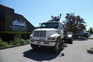2001 International 4700 Dual piston Hook roll off,pintle hitch.