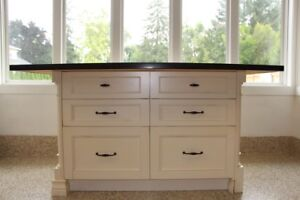 Kitchen island & cabinetry, countertop. Seats 3, great storage.
