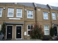 Three bed, two bath town house, private garden, home office, off-road parking near shops and buses