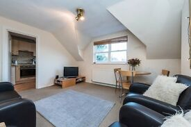 A well-presented, three bedroom Victorian conversion top floor flat