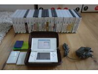 Nintendo DS lite, carry case, charger, rumble pack and 24 games