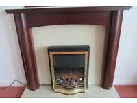 """Dimplex 2KW electric fire plus """"Marfil"""" stone hearth and backplate plus surround."""