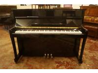 New polished ebony upright piano with stool and free delivery