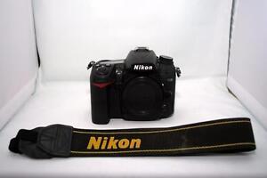 Nikon D7000 DSLR Bundle - (Body, Strap + Wall Charger)