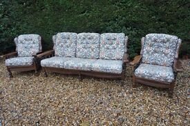 Very solid wooden framed 3 person sofa + 2 matching arm chairs