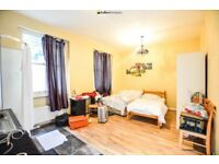 This superb studio flat with private garden in West Kensington