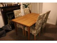**SOLID WOOD DINING TABLE WITH 4X CREAM FLORAL DESIGN CHAIRS****