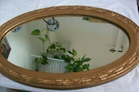 Vintage French wooden framed oval mirror. Gold coloured