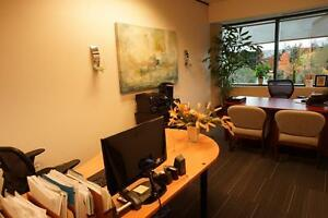 Spacious Offices with full desks and work areas.
