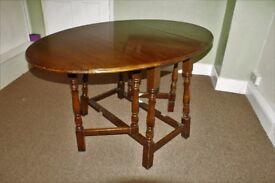 Oval,dark oak, gate-leg dining room table