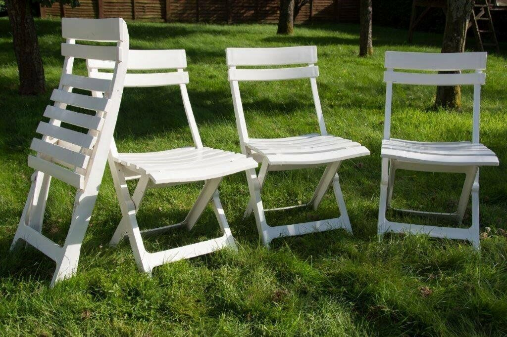 five white plastic folding garden chairs in Basingstoke