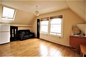 **one bedroom top floor flat located stone throws away from Finsbury Park**