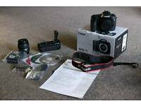 Canon 7D DSLR camera, lens, battery grip, professional photography, mint condition low shutter count