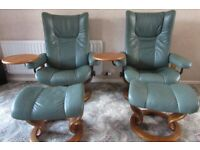 Pair of reclining Stressless leather chairs with matching footstools