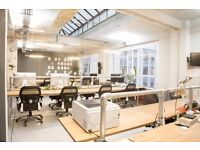 Desks and private spaces in a beatiful industrial office building