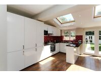 Brand new 4 bed house in Motspur Park