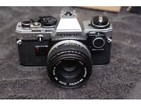 Olympus OM10 35mm SLR Film Camera with 50mm f1.8 Zuiko Lens