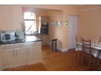 Spacious furnished 2 bedroom ground floor flat with garden and driveway parking in Murrayfield