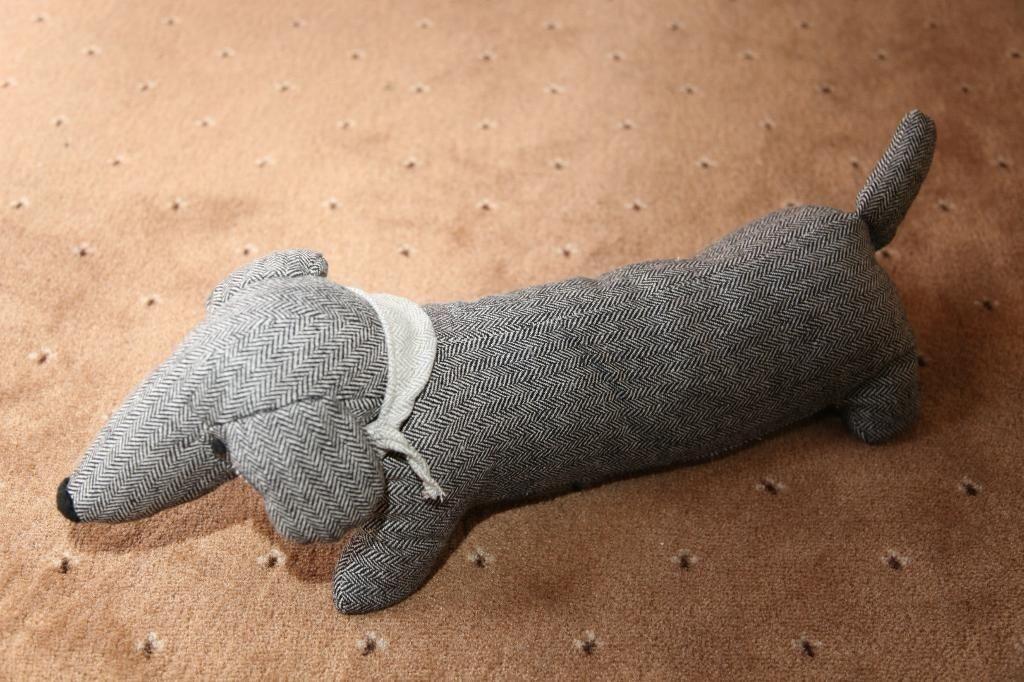 Sausage dog door stopper in norwich norfolk gumtree - Dog door blocker ...