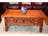 SOLID WOOD COFFEE TABLE with drawer, teak colour and in very good condition. Collect nr. Swansea Vy.