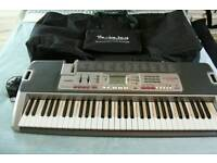Casio LK-210 keyboard with carry case