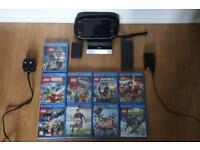 Sony PS Vita with 9 games, case and charging stand