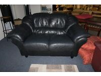 Small black leather style sofa
