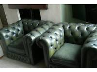 Two green leather Chesterfield club chairs/sofas