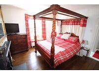 King Size Four Poster Bed, Solid Mahogany with decorative ornate carved posts, headboard & feet.