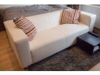 Ikea White Leather Sofa and lug mat and coffee table