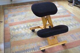 Kneeling chair with castors. Height adjustable.