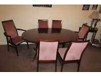 Dining table 4 chairs, 2 carvers brass table feet. Dark wood good condition,buyer collects