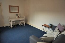 Well presented 1 bedroom flat with modern fitted kitchen and separate lounge - available immediately