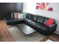 Large black leather corner sofa from IKEA + free coffee table.