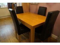 SOLID DINING TABLE AND FOUR FAUX LEATHER CHAIRS - BEAUTIFUL WELL MADE SET
