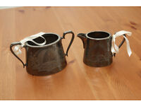 Pewter milk jug and sugar bowl