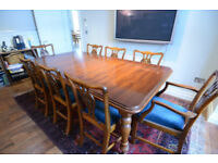 Dining table with 6 chairs and 2 carvers in excellent condition.