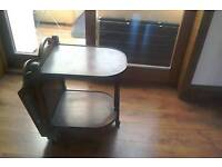 Old antique coffee table and paper rack