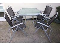 Garden patio- 4 chairs, 1 table, 1 parasol