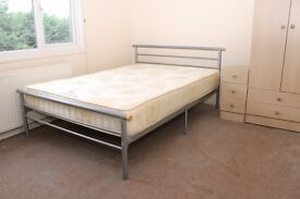 Bright double room with own kitchenette available now for single non-smoking female
