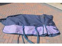 Worn once 5'9 rug (medium weight) knight rider