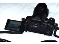 Lumix G1 DSLR Camera complete with battery, charger, 3 lenses, filters and original packaging