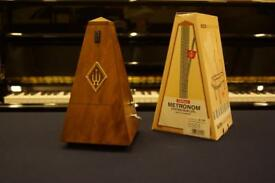 Brand new Wittner metronome with bell in walnut
