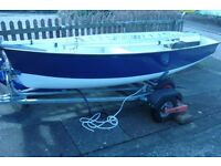 Foxer sailing dinghy number 158 as new and virtually unused, combi trailer, cover, oars