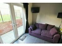 Purple fabric large 2 seater sofa