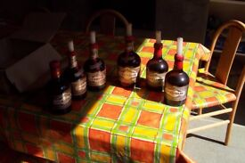 Set of 6 table candles in matching vintage DRAMBUIE bottles with special candle holder inserts