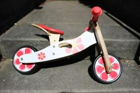 Wooden balance bike for 18-24 month old - brand new. KidzMotion red petal design