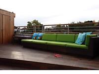 Modular Rattan look Garden Sofa, green and white cushions, brown base